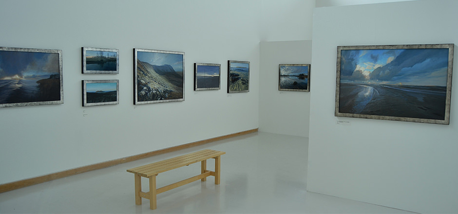 A photograph of Ramsay Gibb's art hanging in a minimalist gallery setting.